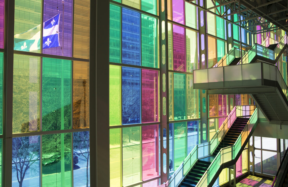 A staircase in front of the colourful windows at the Palais de Congrès in Montreal, Canada, where CHI 2006 and CHI 2018 were held. Image credit: Société du Palais des congrès de Montréal Royalty Free Photos.