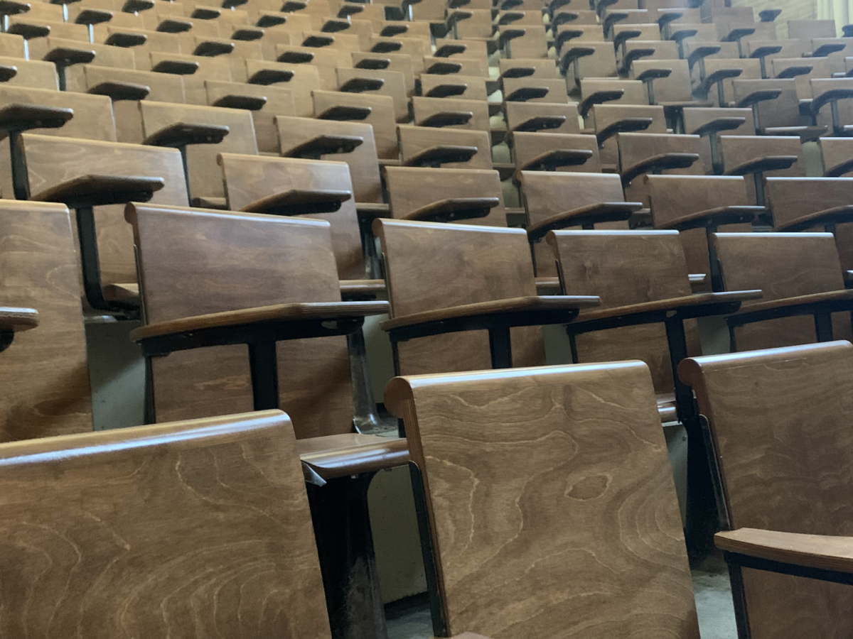 Rows of empty chairs in a lecture hall.